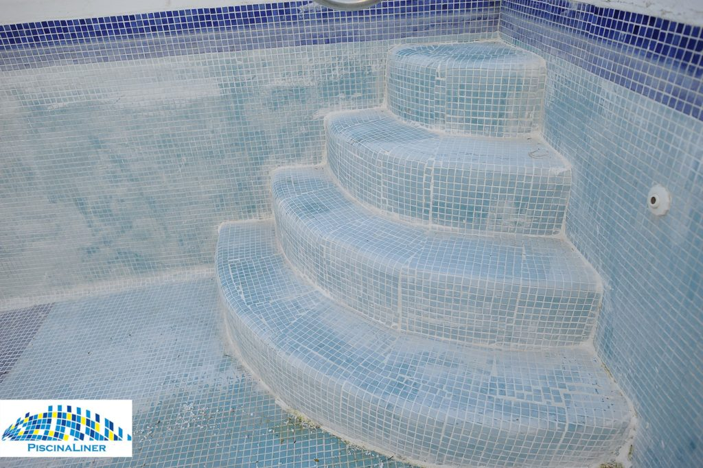 Calcium stained pool tiles